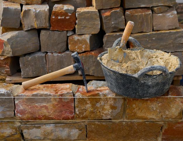 construccion-muros-piedra-herramientas_79295-17764