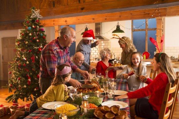 depositphotos_117316528-stock-photo-family-christmas-dinner