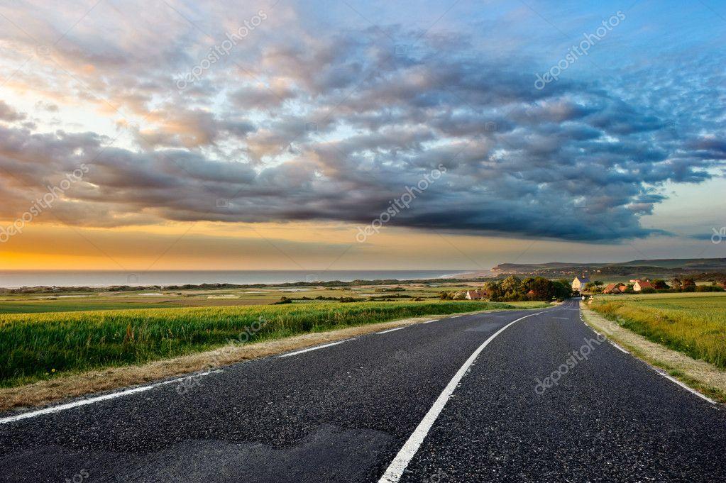 depositphotos_12727901-stock-photo-coastal-road-at-sunset